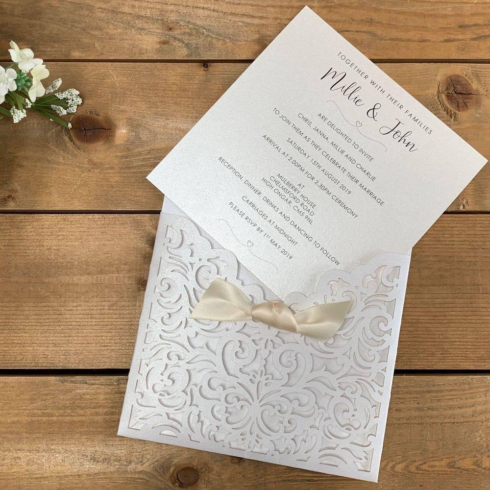 Laser cut wedding invitations in Ivory