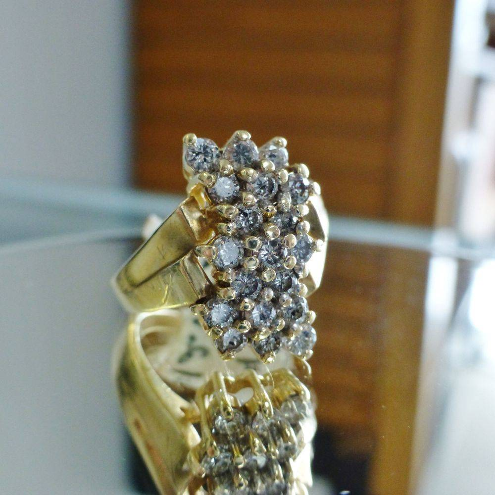 close up picture of a yellow gold waterfall ring with round cut diamonds