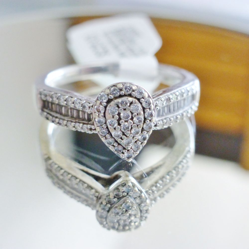 Close up picture of a white gold engagement ring with a pear shaped frame diamond composite in white gold