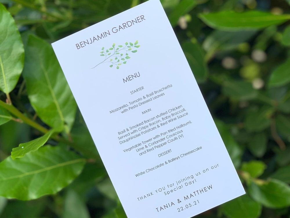 White menu card with guest name - with leaf branch detail