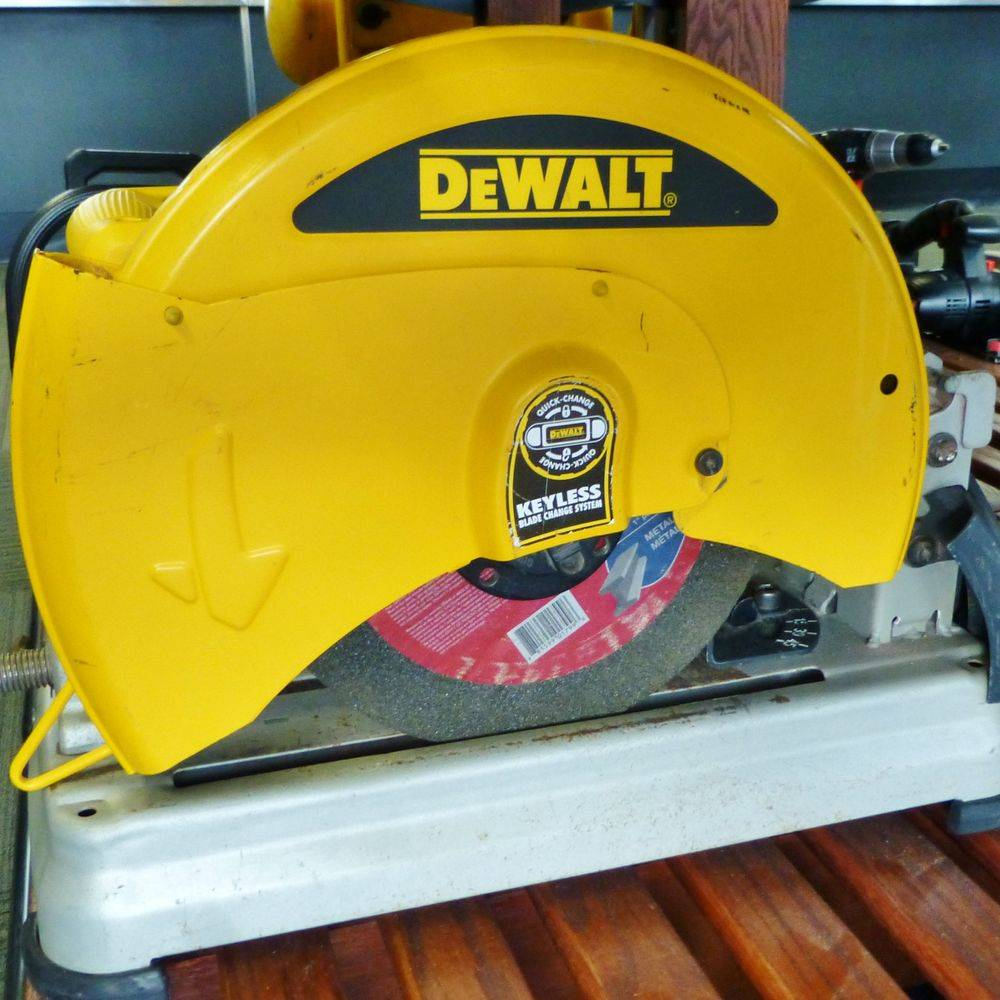 Closeup picture of a Yellow DeWalt Chop Saw on a Wooden Shelf