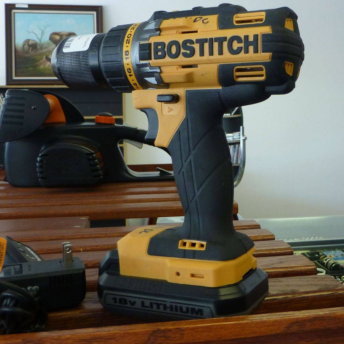 Yellow And Black Bostitch Power Drill On A Brown Shelf