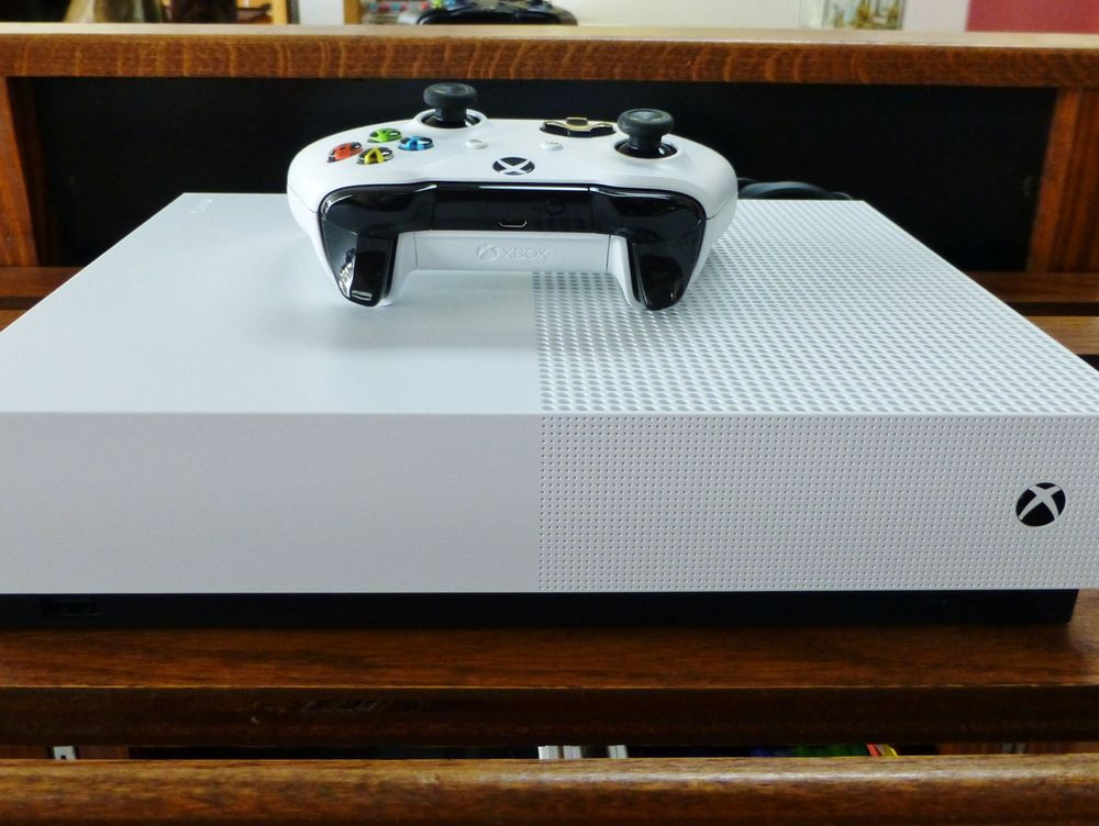 closeup picture of a white xbox one s digital edition game system