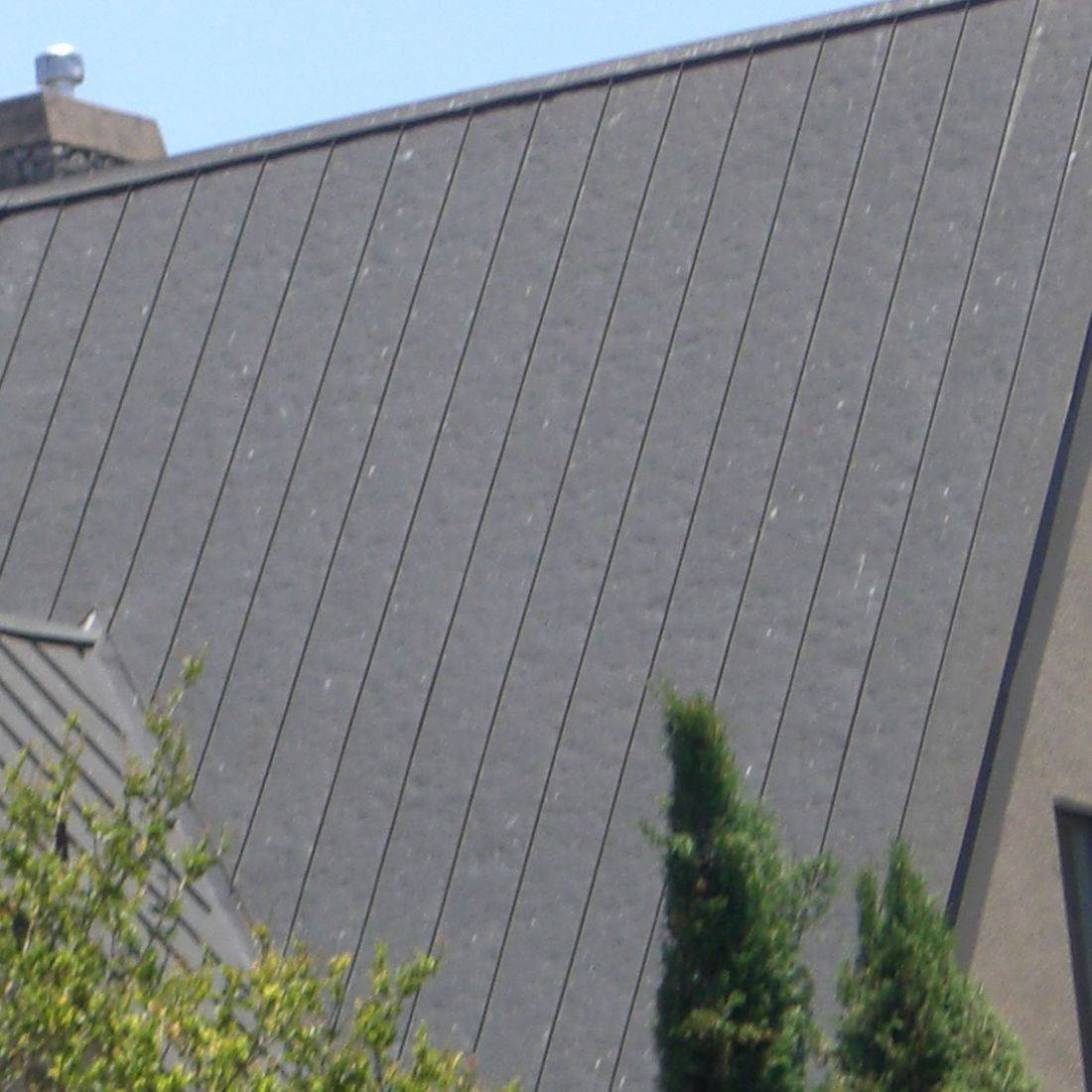 Metal roof dented from hail damage