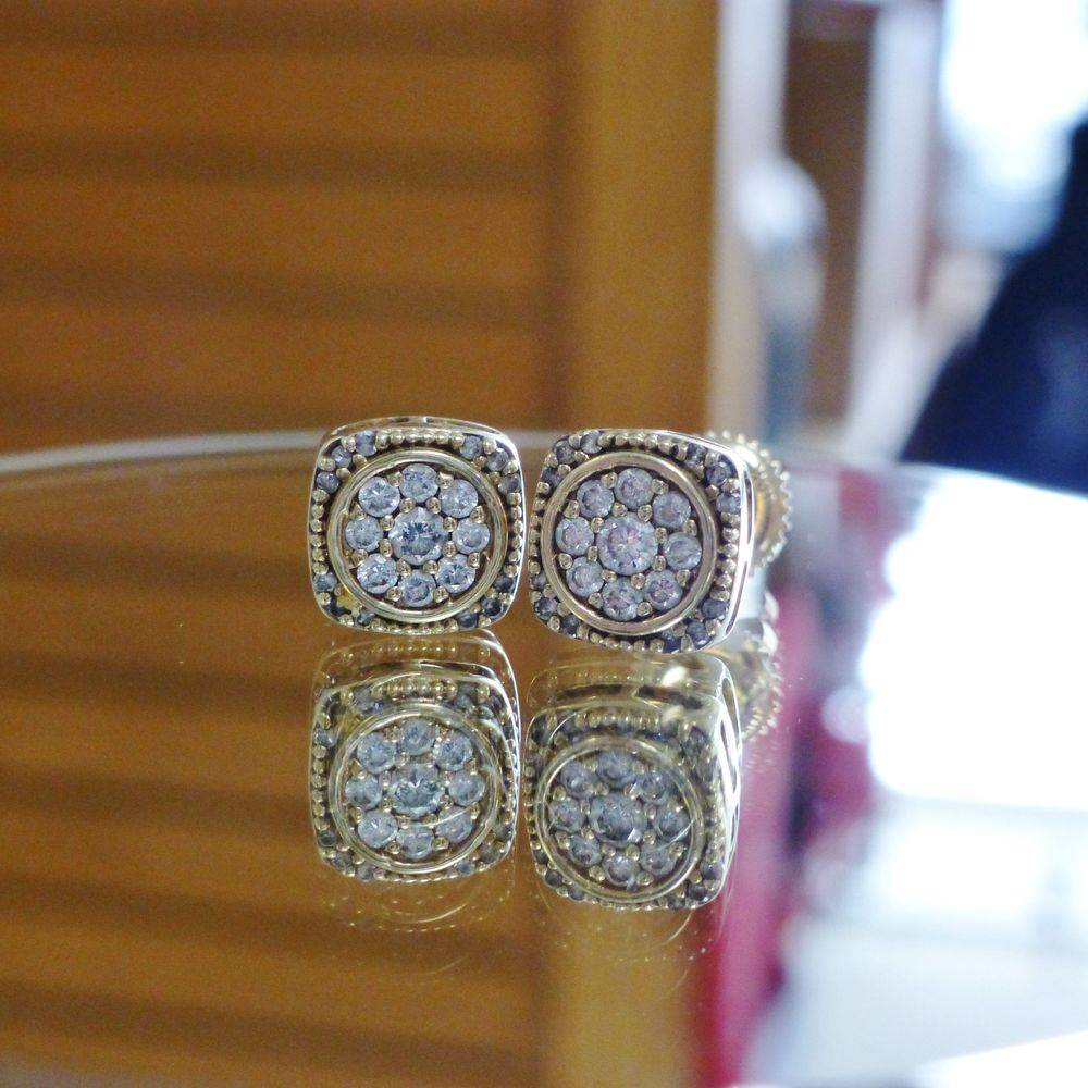 close up picture of yellow gold cushion frame round cut diamond composite stud earrings