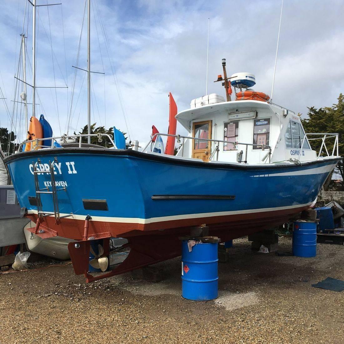 Fishing boat Osprey II ashore at Keyhaven