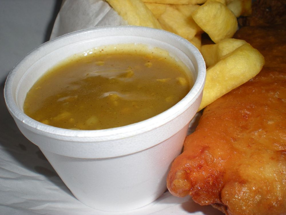 Small pot of spicy curry sauce served piping hat from our fish and chip van.