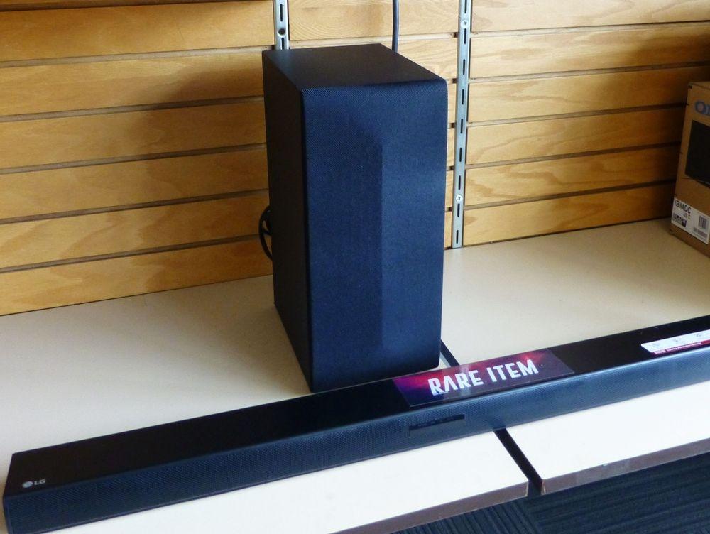 Closeup picture Lg Soundbar and wireless subwoofer sitting on a shelf