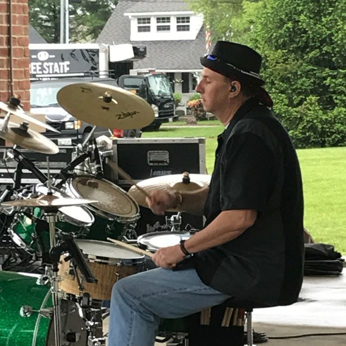 Brian Frew playing the drums for the Mojo Priests