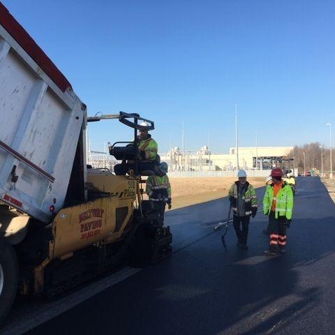 industrial asphalt paving crew