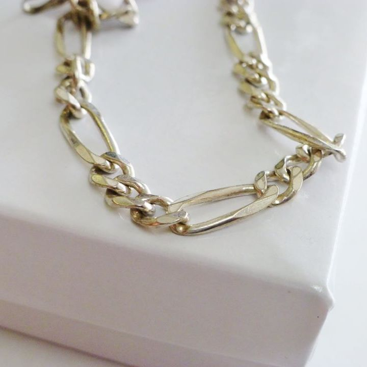 mens sterling silver figaro link bracelet on a white box