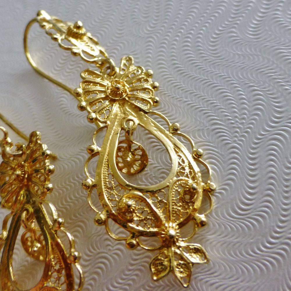 closeup picture of pair of gold plated silver filigree dangle earrings