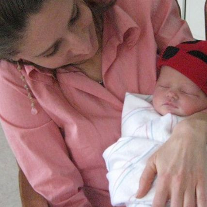 midwife holding baby
