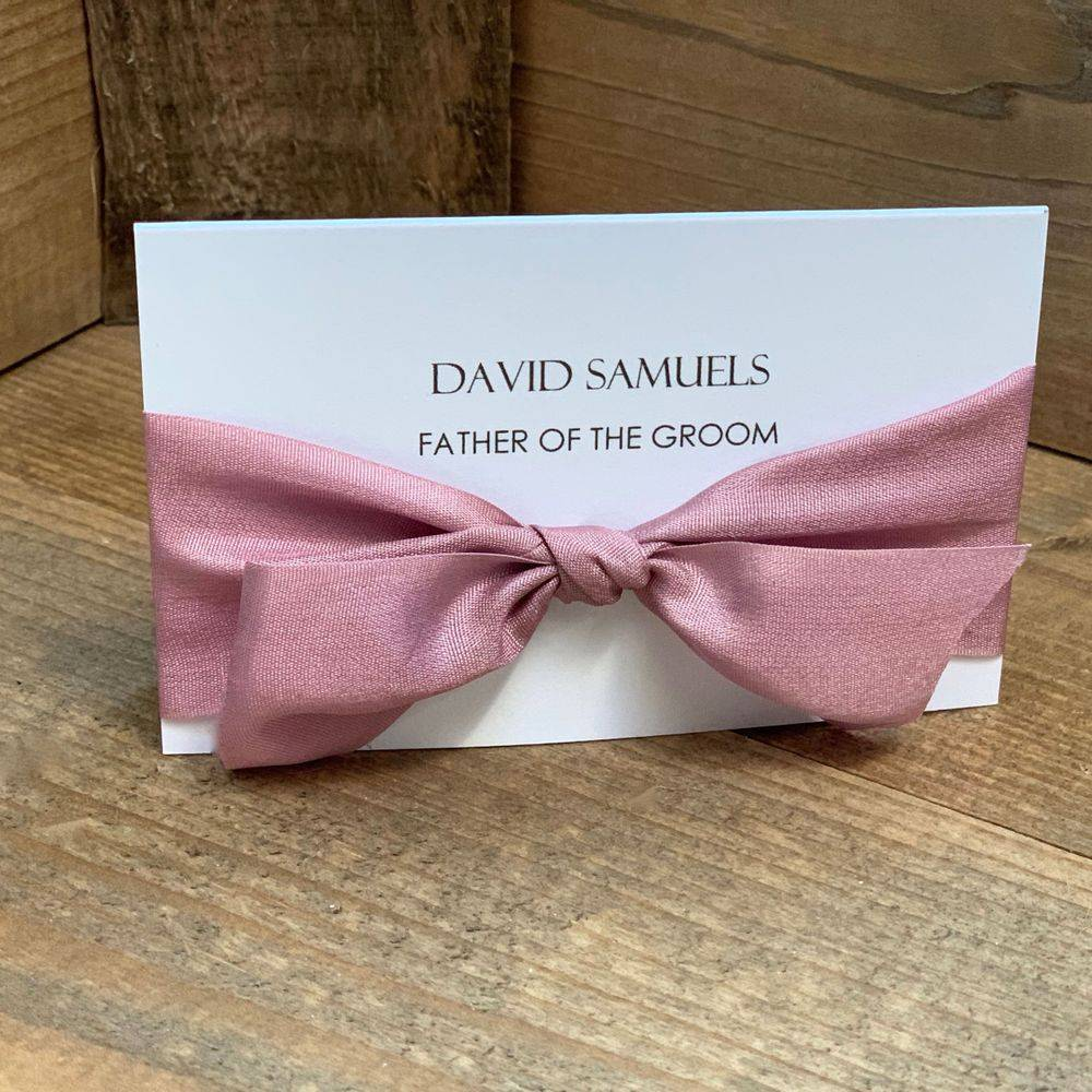 White place name with printed guest name and dusky pink pure silk ribbon