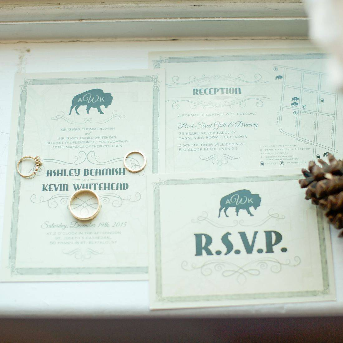 Vintage, green Buffalo-themed wedding invitations