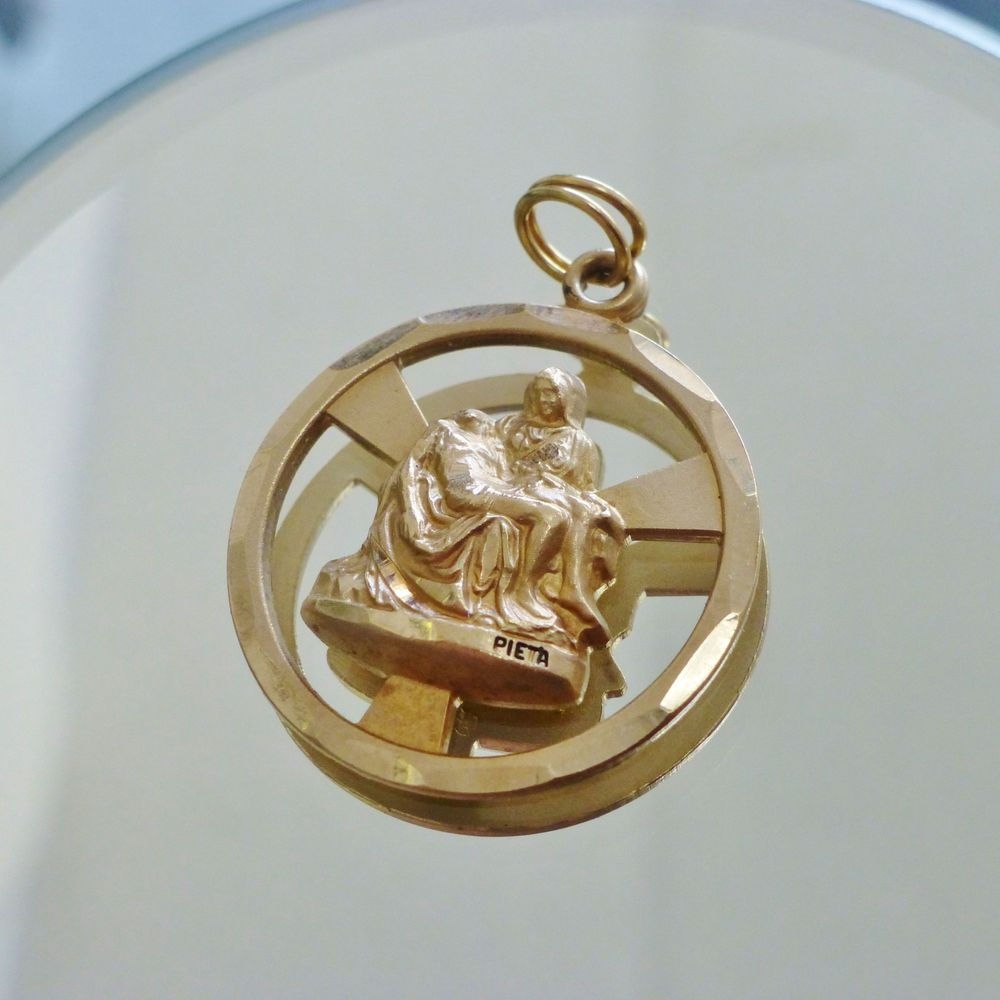 Close up picture of the Pieta Medal by Michelangelo 14K gold pendant