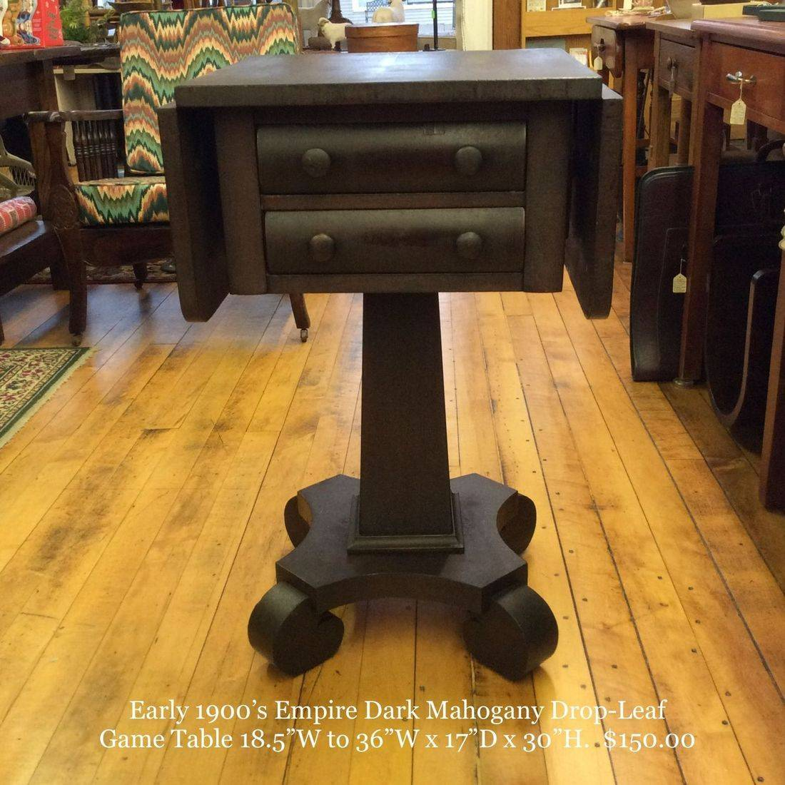 """Early 1900's Empire Dark Mahogany Drop-Leaf 2-Drawer Game Table  18-1/2""""W to 36""""W x 17-1/8""""D x 30""""H.  $150.00"""