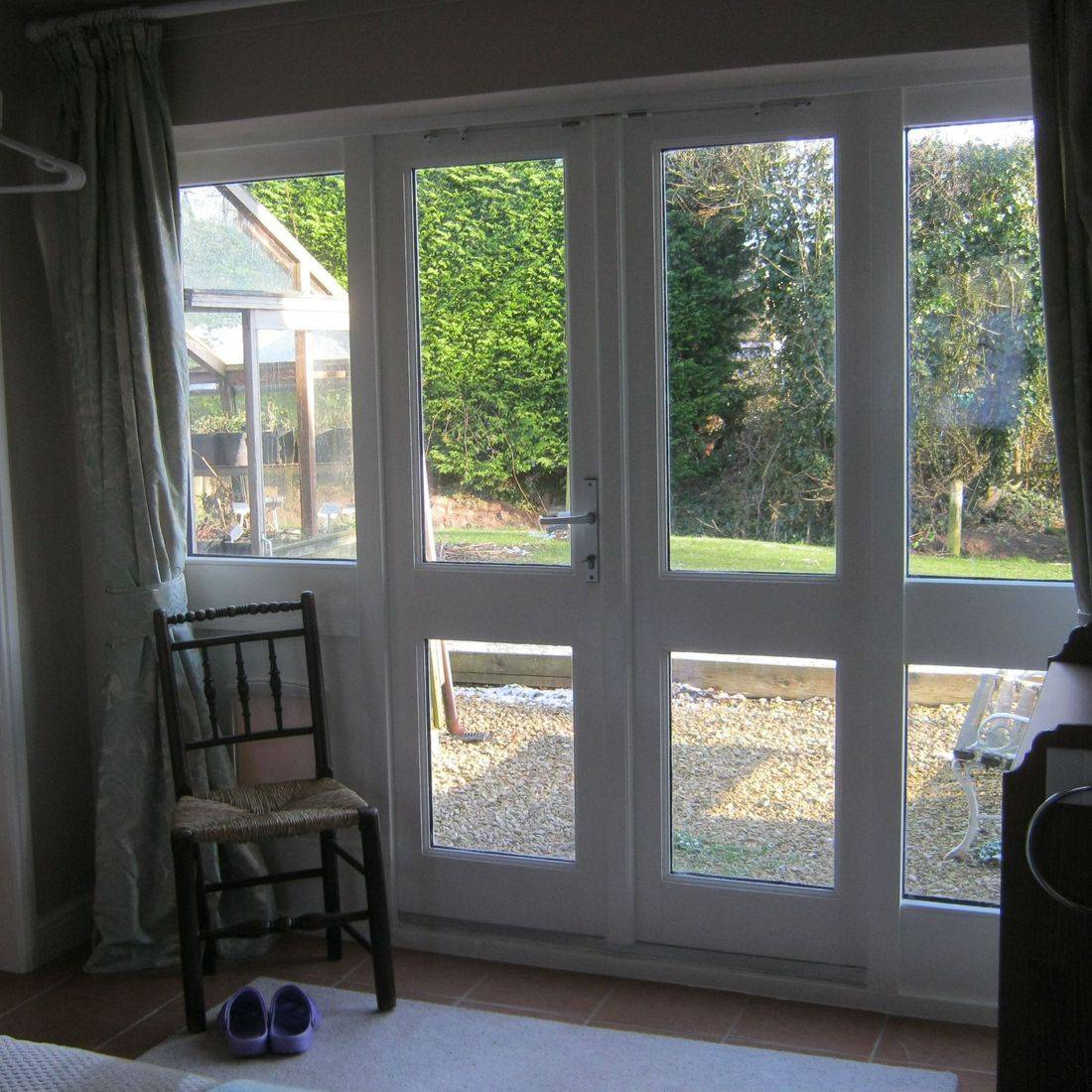 cottage bed and breakfast room french windows to garden