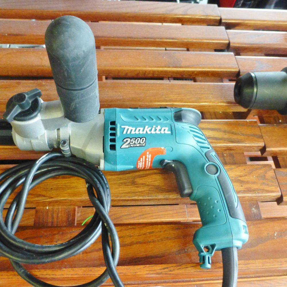 Makita Teal Corded Drill on wooden slatted shelf