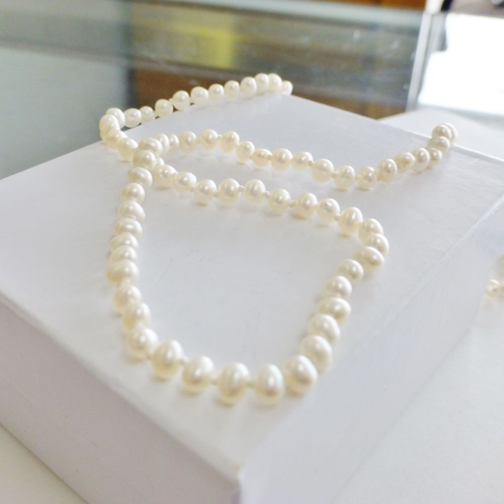 White Pearl Strand Necklace with a 14K Yellow Gold Clasp