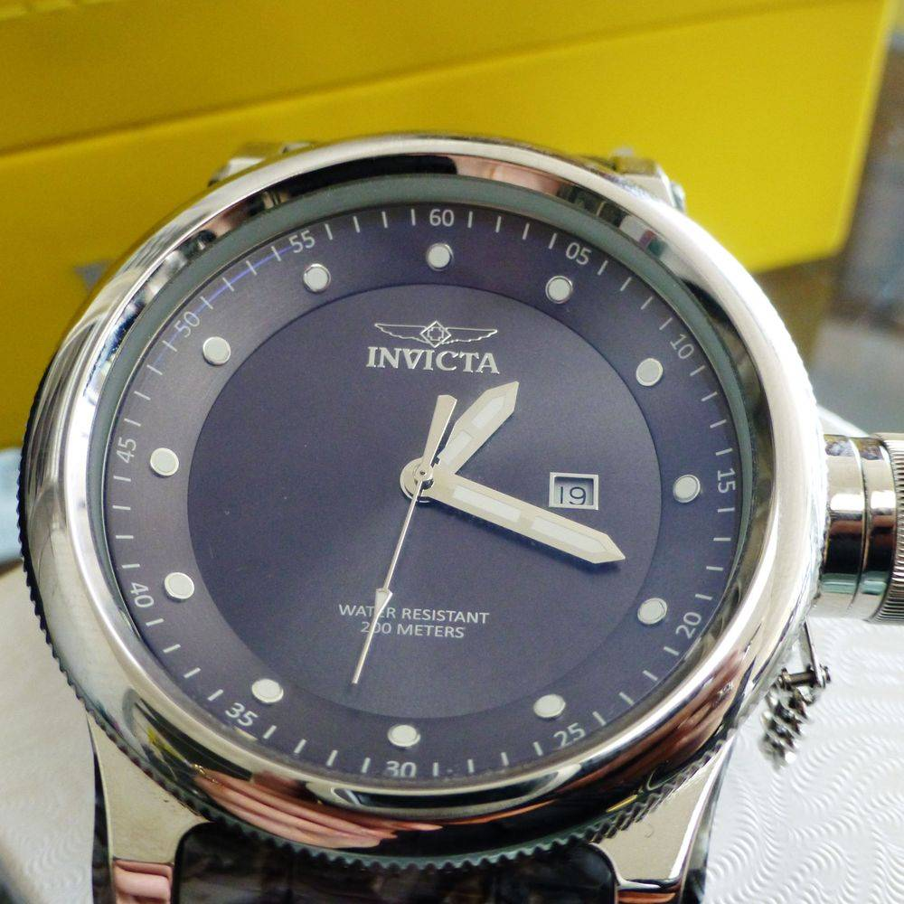 Close up picture of a men's invicta watch face