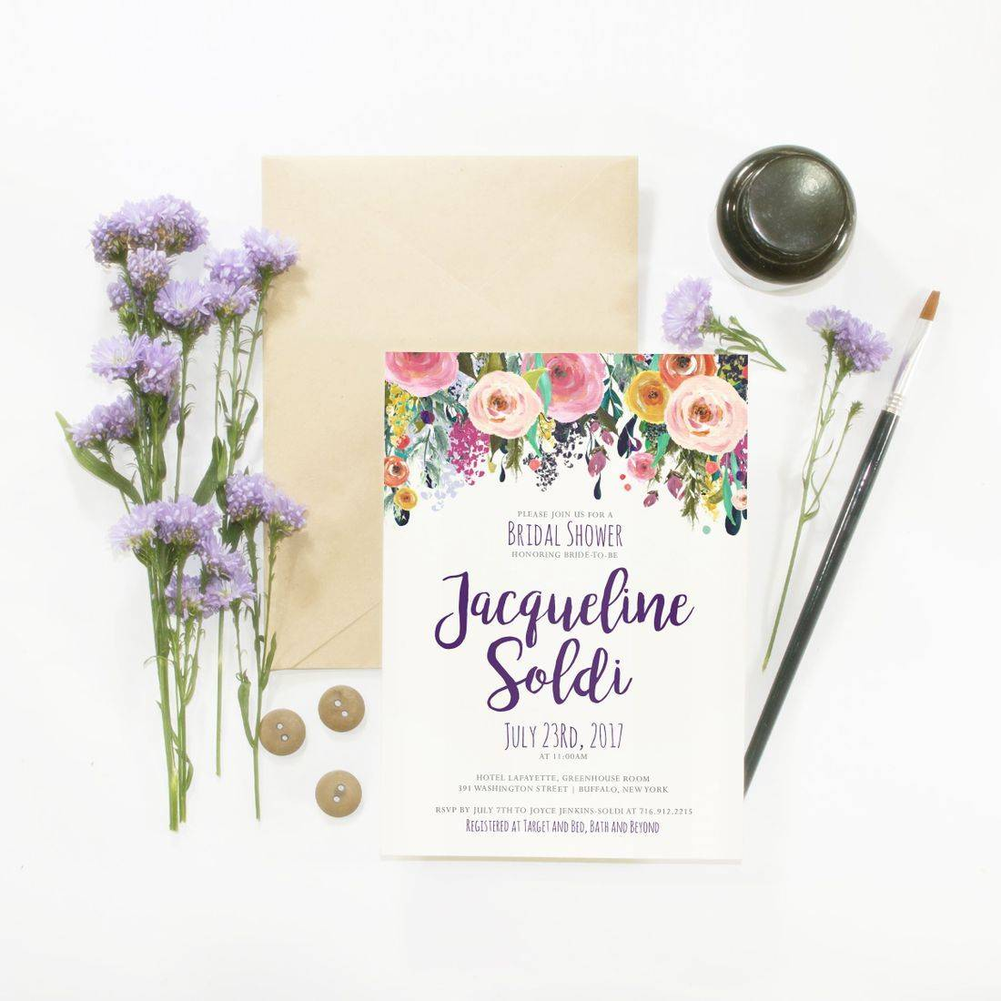 Colorful floral bridal shower invitation flat lay