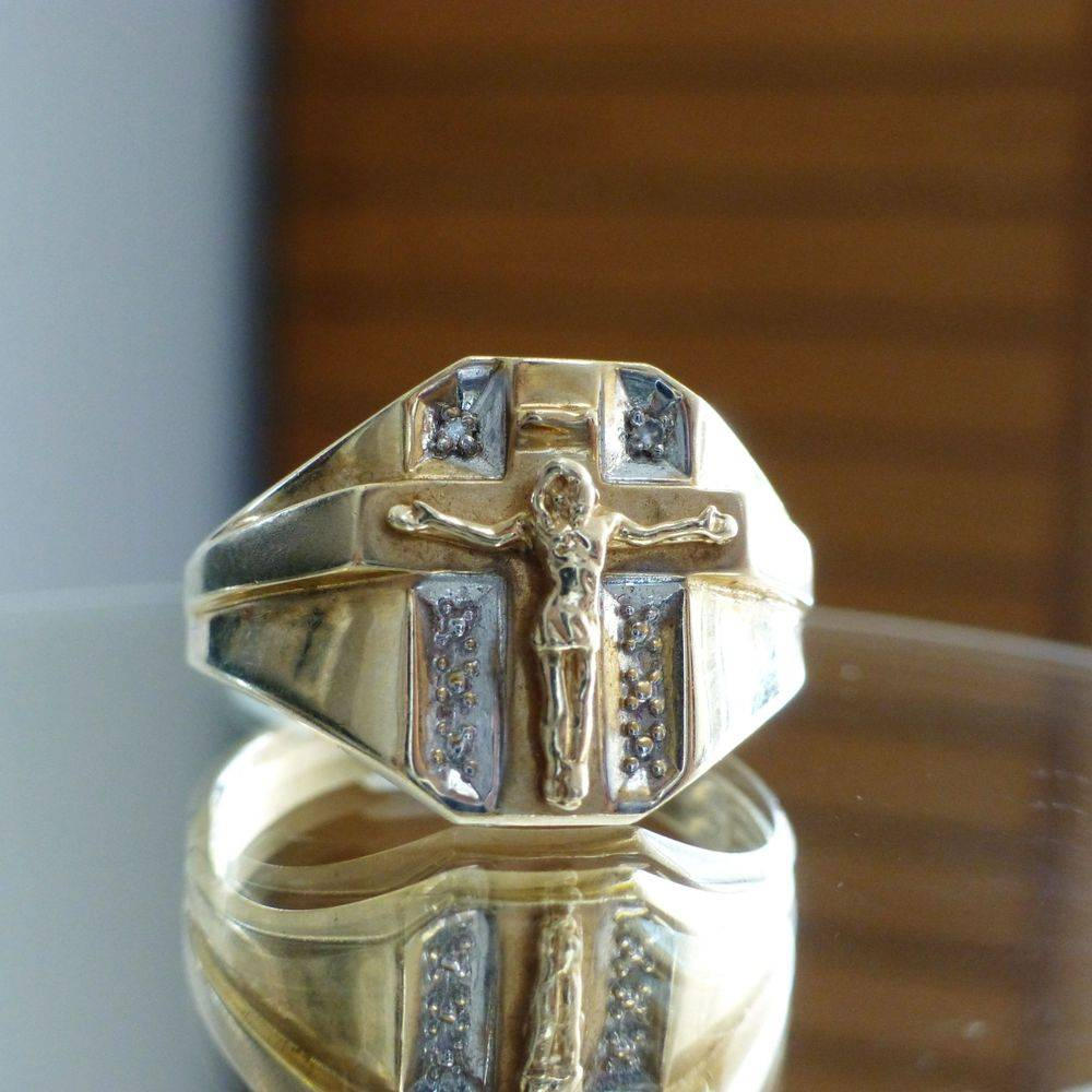 Closeup picture of a diamond accent Crucifix cross men's ring in two tone gold