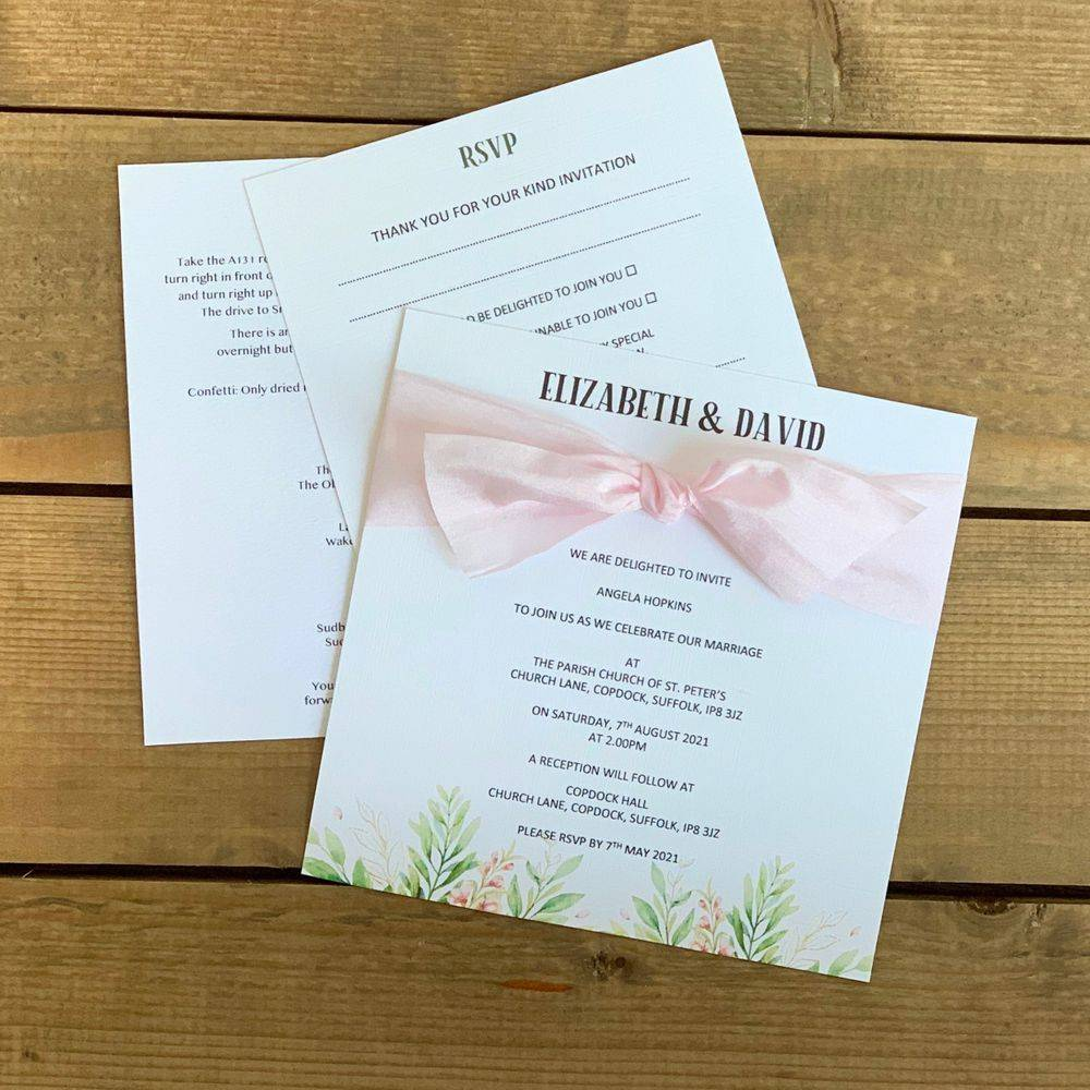 Pink and white wedding invitation withsilk ribbon