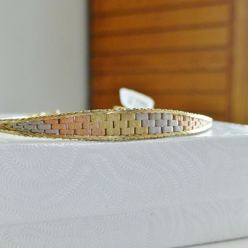 closeup picture of a tri color gold tapered vintage bracelet