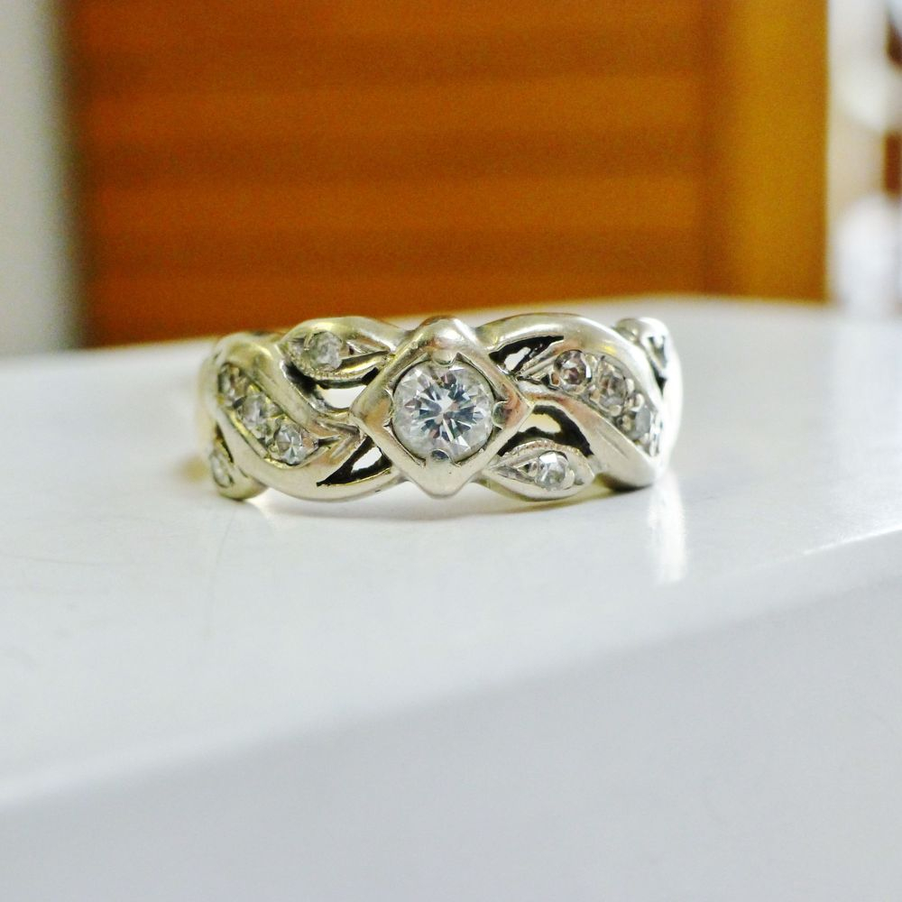 Two Tone Gold Engagement Ring With Diamonds in a Swirling Design