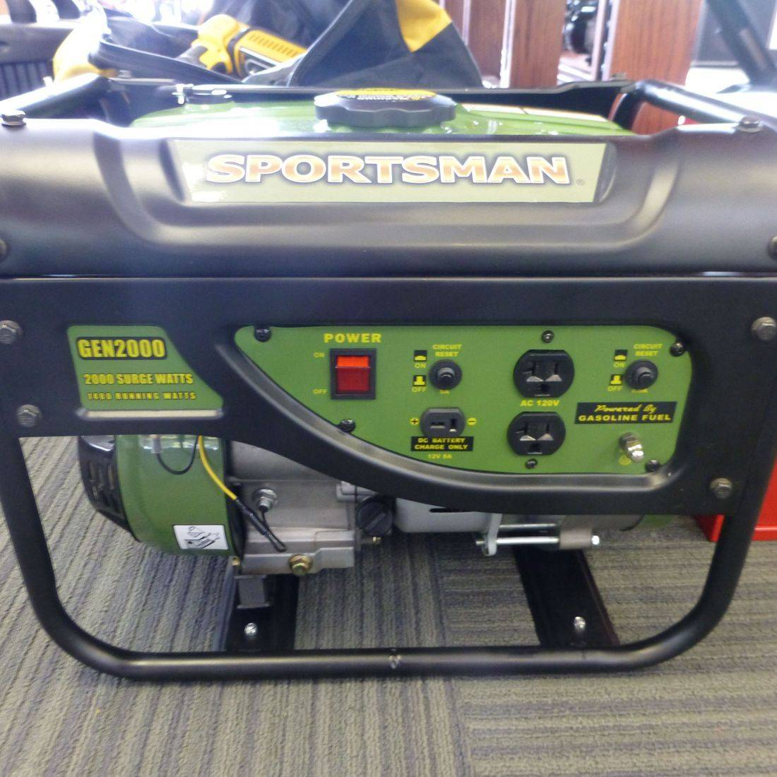 Black and Green Sportsman Generator Sitting On a Blue Carpeted Floor