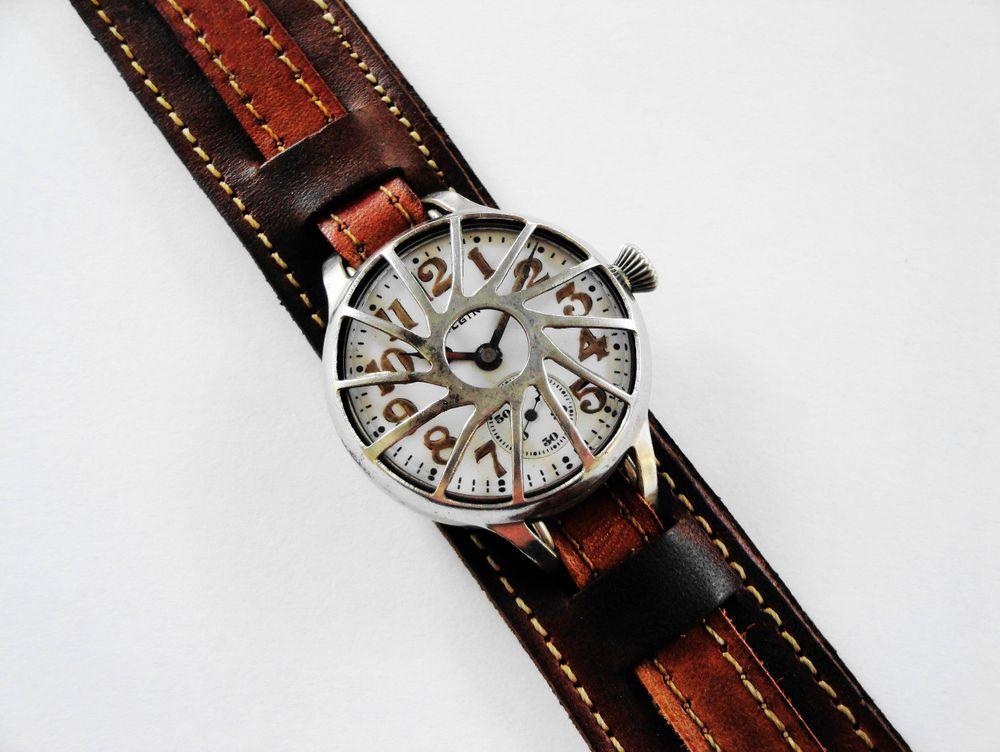 "1914 WWI Elgin Trench Watch, Originally Belonged to US Army Private William L. Casey, Served in France, Philadelphia Silverode Case, Case Back Inscription, Original Factory Crown, Original Factory Lume, Frank Farr ""Pinwheel"" Crystal Guard, Original Factory Crystal, BOLD Arabic Enamel Military Dial, Dark Brown Leather Kitchener Strap"