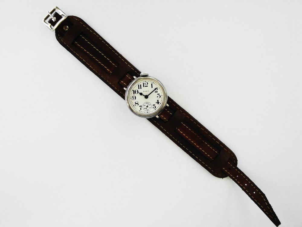1917 WWI OFFSET CROWN Elgin Trench Watch, Sterling Silver Philadelphia Case, Original Factory Crown, Semi-Hermetic Threaded Case, 7 Jewels, Size 3/0s, BOLD Arabic Enamel Military Dial, Correct Thick Blue Steel Hands, Dark Brown Leather Kitchener Strap
