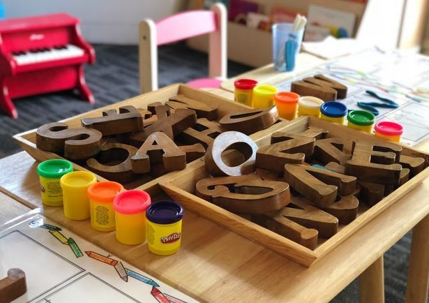 Preschool classroom with block letters and play dough