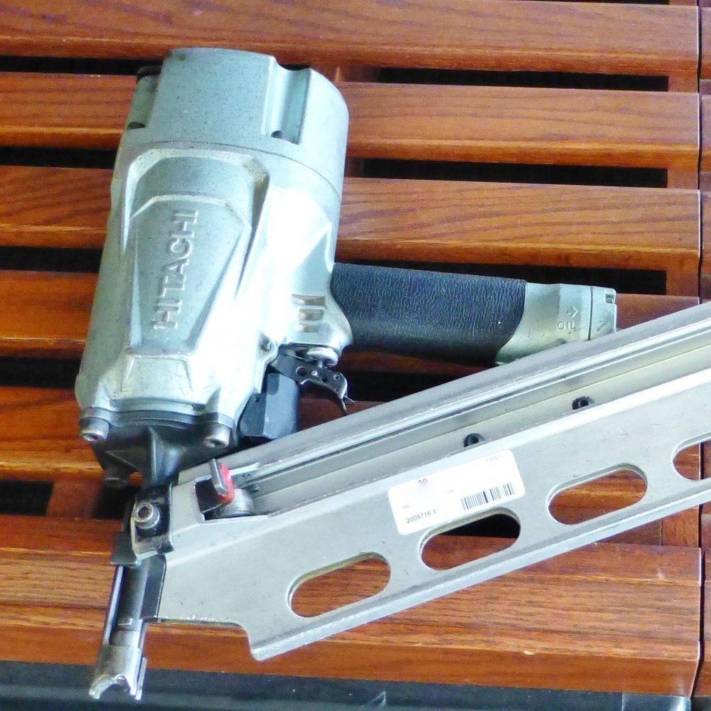 close up picture of a Hitachi framing nail gun laying on a shelf