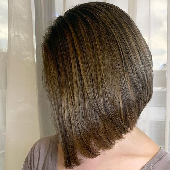 Brunette angled bob with caramel babylights