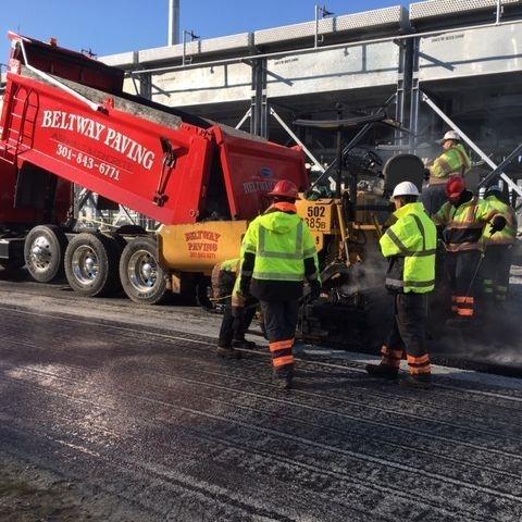 Crew Installing Asphalt Pavement