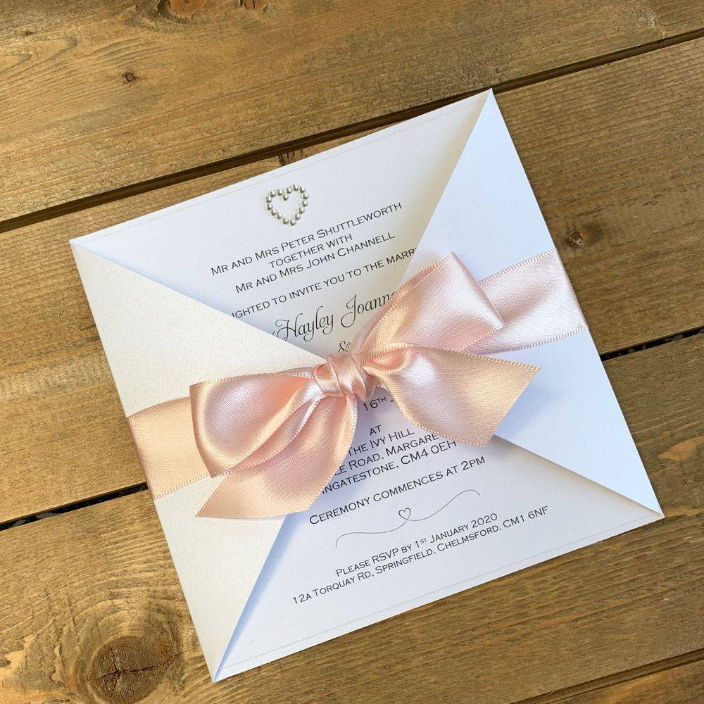 wedding invite tied with ribbon