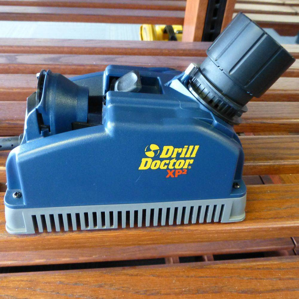 closeup picture of a blue drill doctor drill bit sharpener