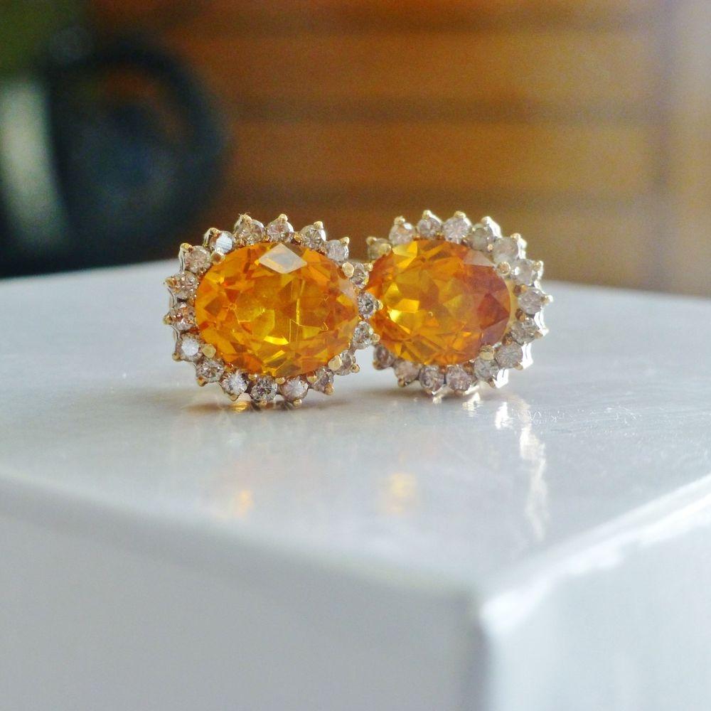 Oval Cut Yellowish Orange Maderia Citrine Gemstone earring with a diamond halo