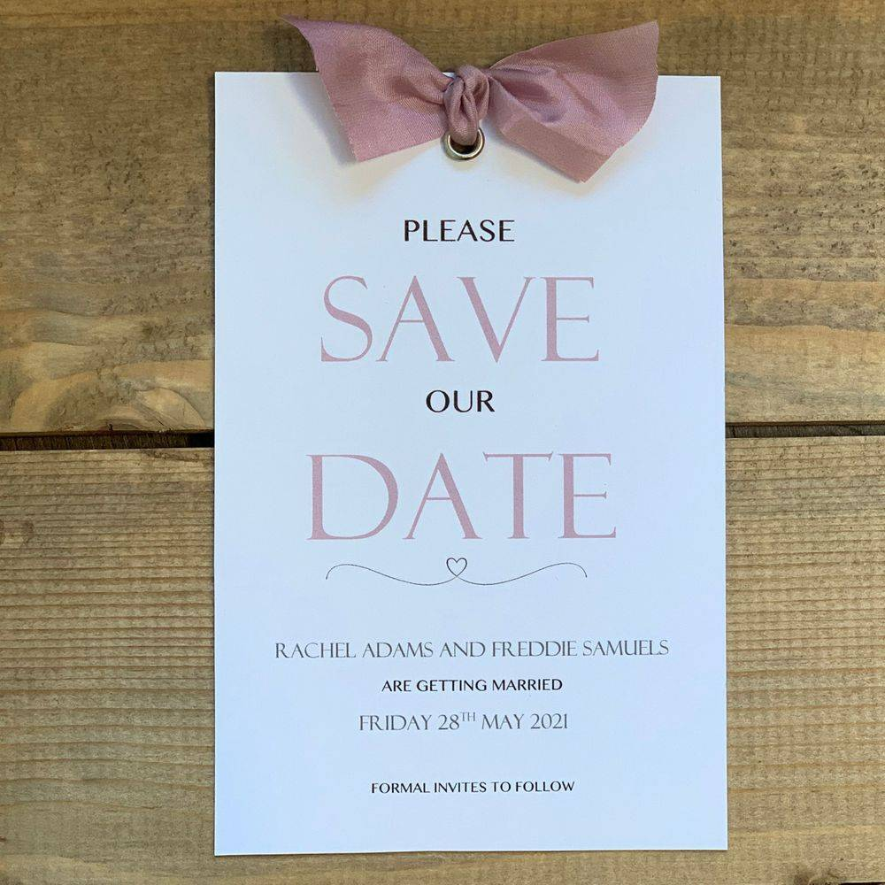 White and dusky pink save the date card
