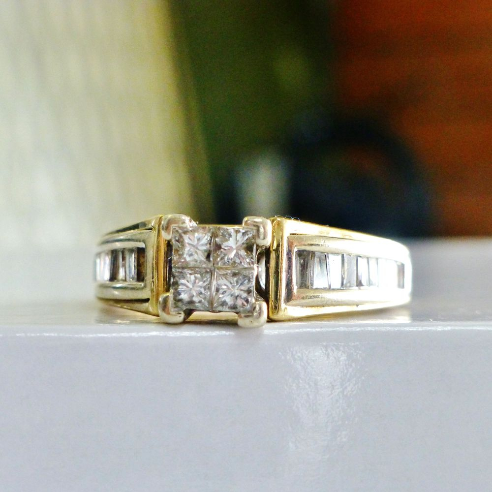 Princess Cut Diamond Quad Prong Set and Centered in Yellow Gold engagement ring with side baguette diamonds