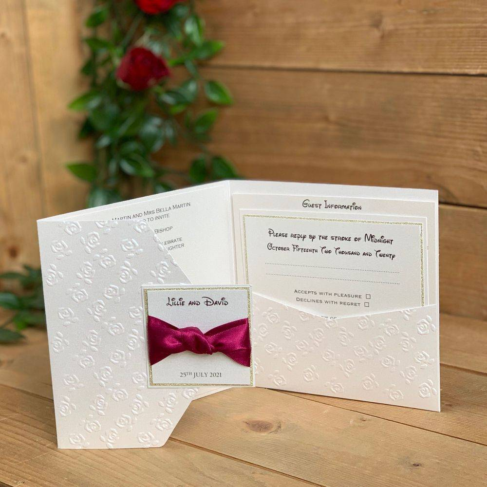 Disney Wedding Stationery in UK , Beauty and the Beast Wedding Invitation, Ivory with embossed roses, gold glitter and Wine Satin ribbon