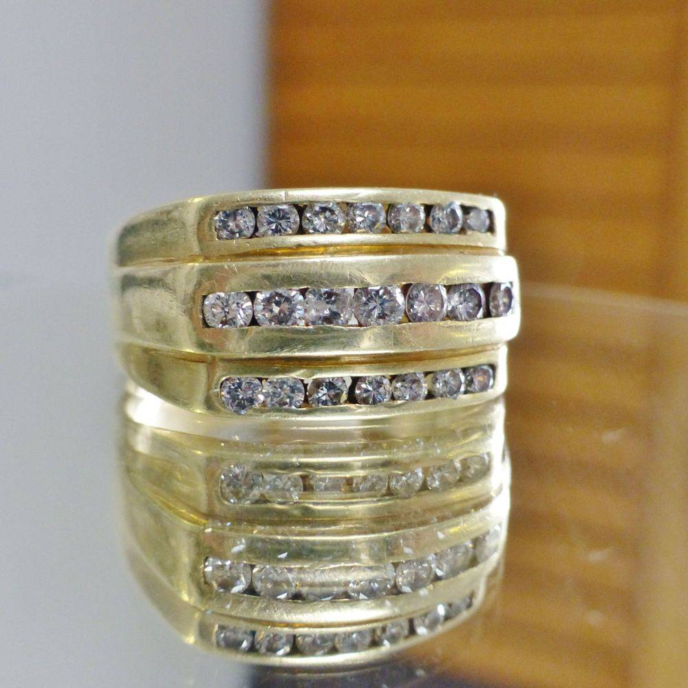 Close up picture of an emerald cut citrine diamond accent ring