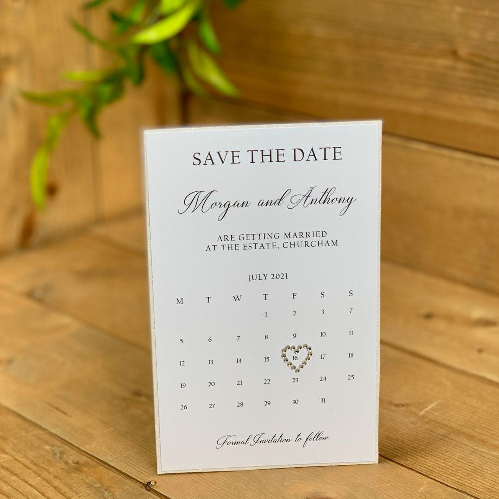 White with white glitter  Save the Date tags with magnetic disc to reverse