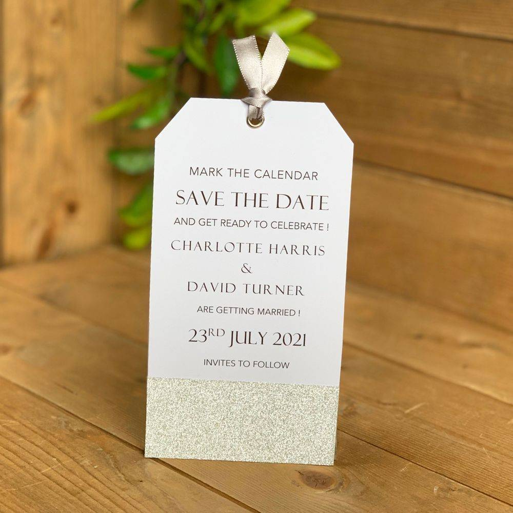 White with silver glitter  Save the Date tags with magnetic disc to reverse