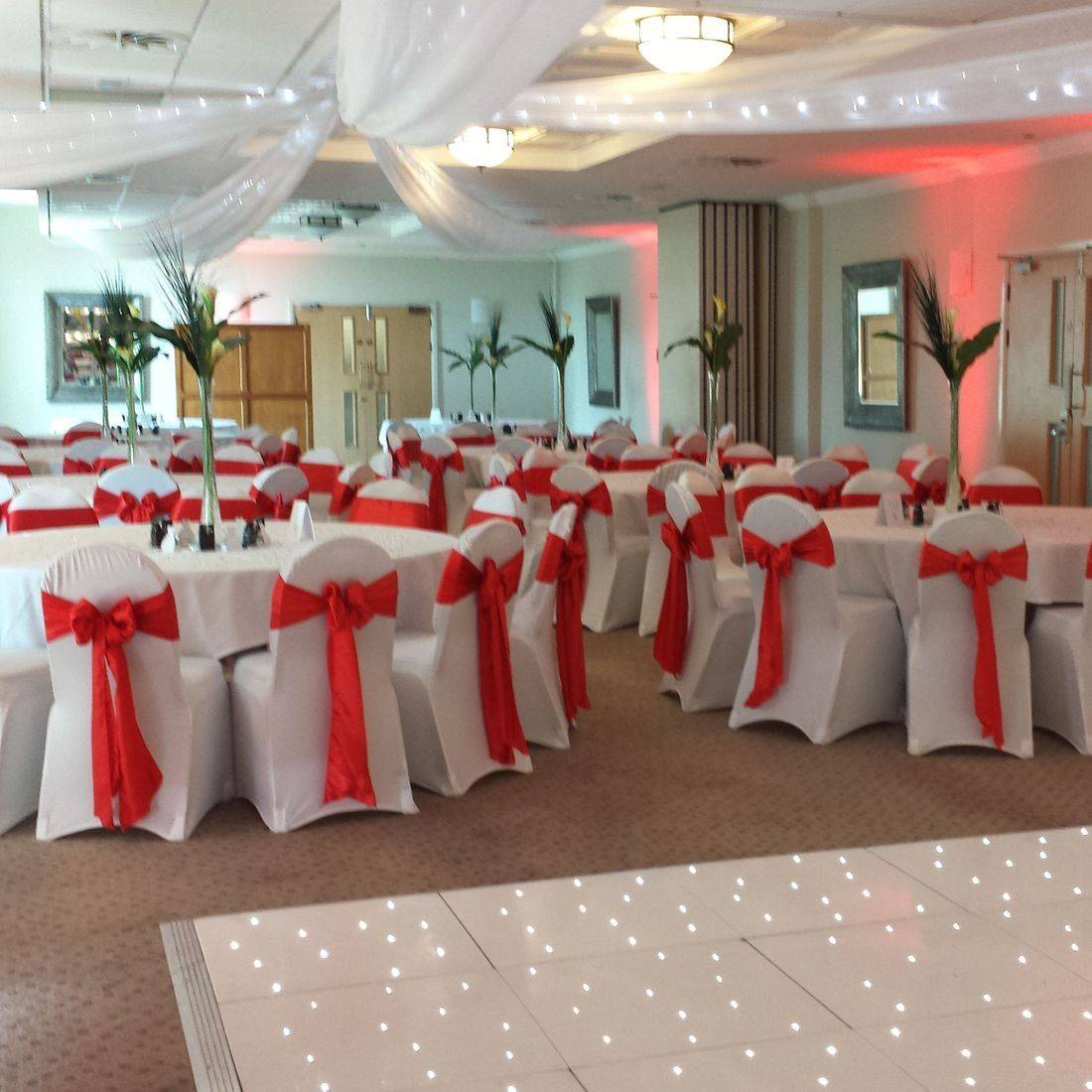 White Chair Covers with Red Satin Sash