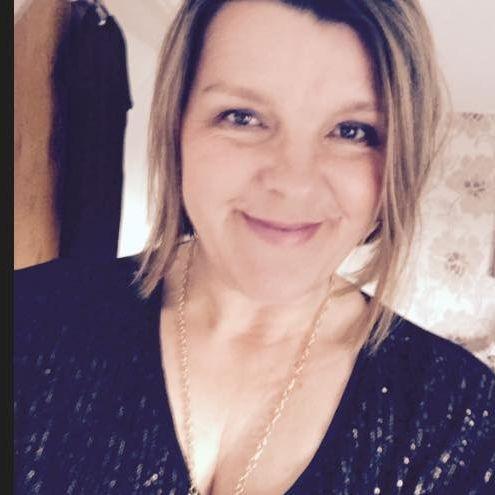head photo of Melanie the director