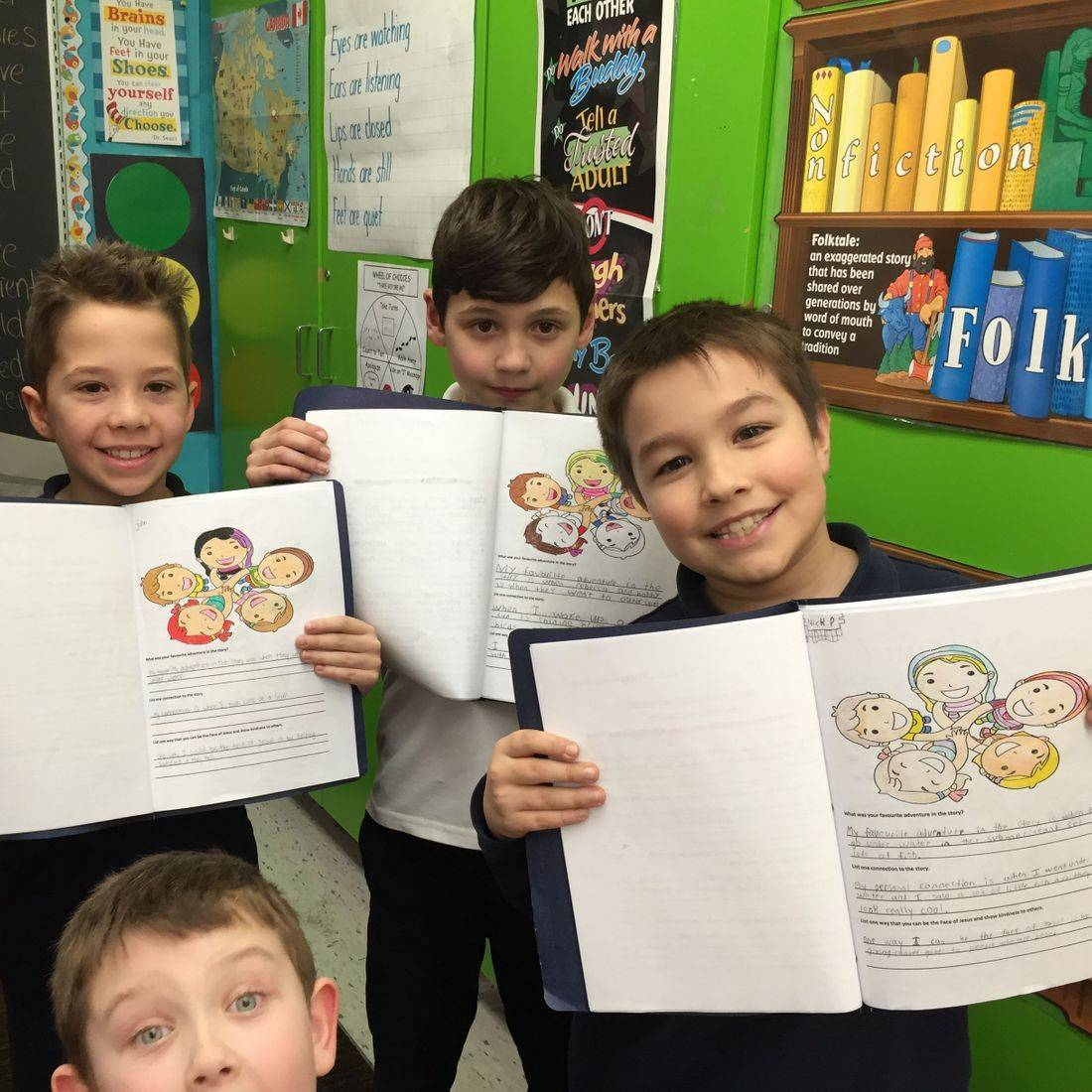 Grade 3 boys proud of their writing and colouring about the book Lucky Stars by Daniella Grsic