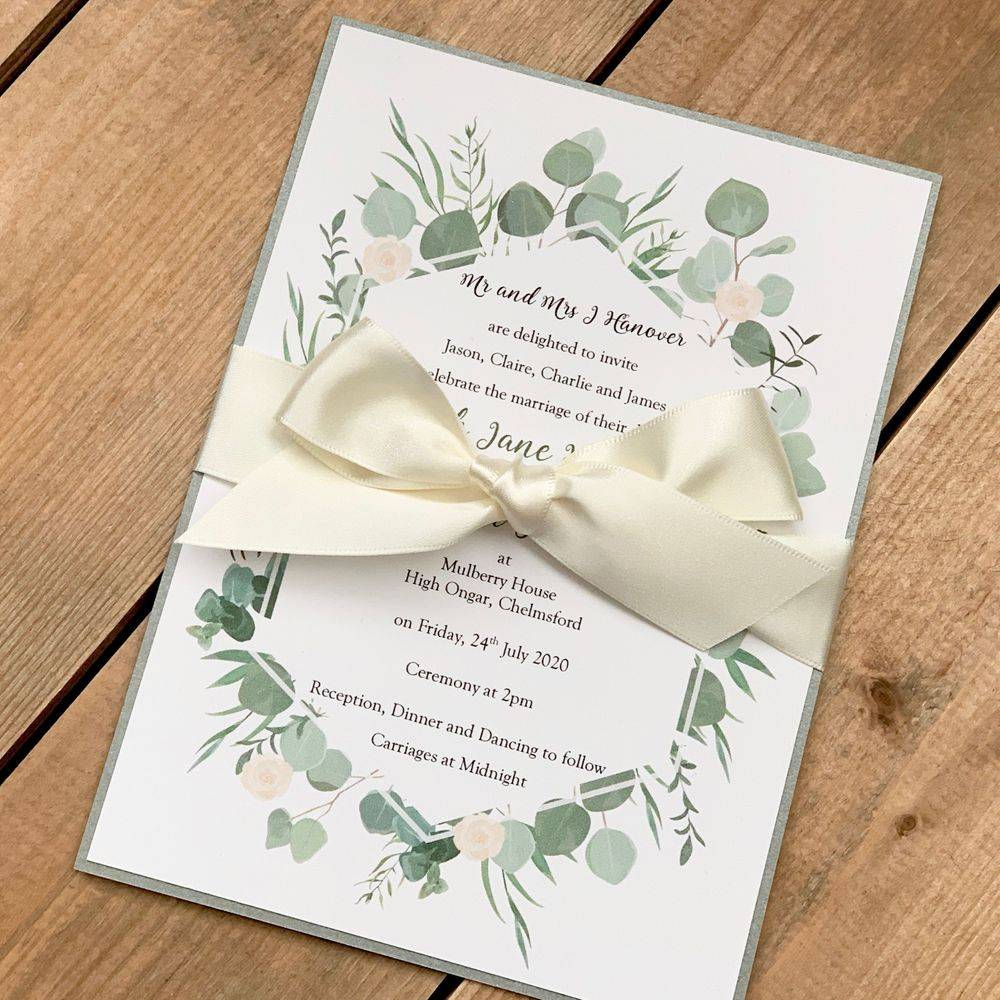 Wedding invite with eucalyptus and roses